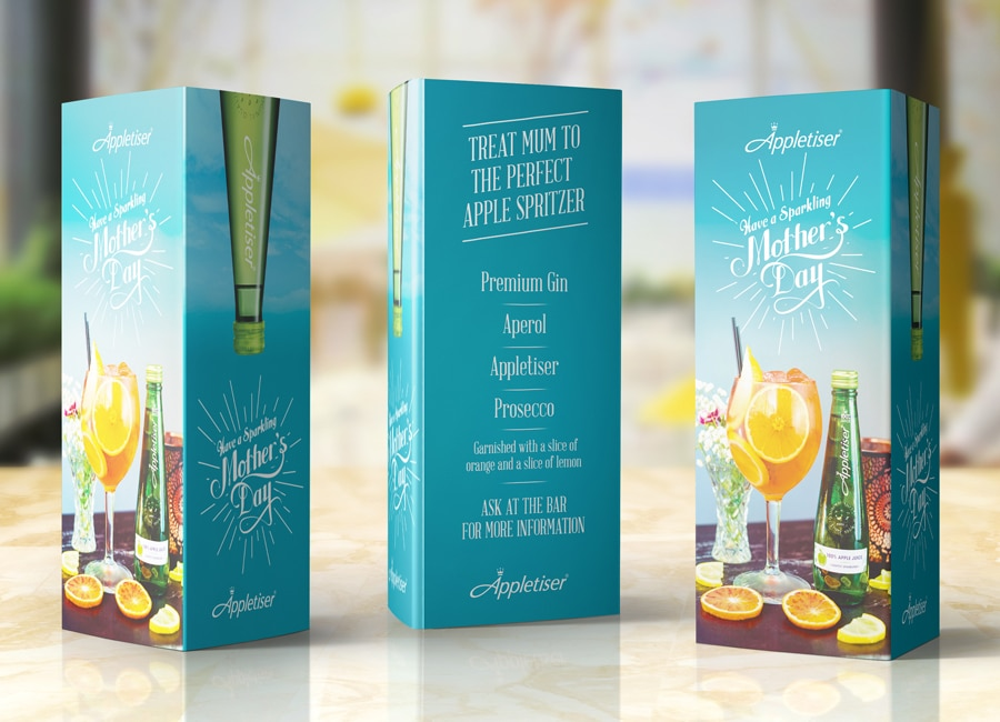 appletiser tent cards displayed in a bar - graphic design in Newcastle
