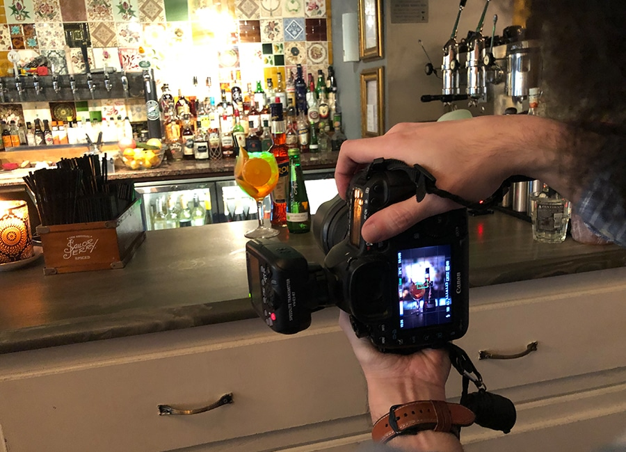 photographer taking pics of appletiser cocktail in a bar - graphic design in newcastle