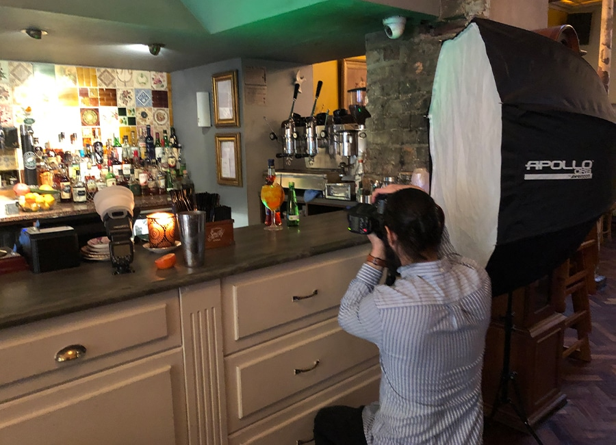 photographer taking pictures of appletiser cocktail in a bar - graphic design in newcastle