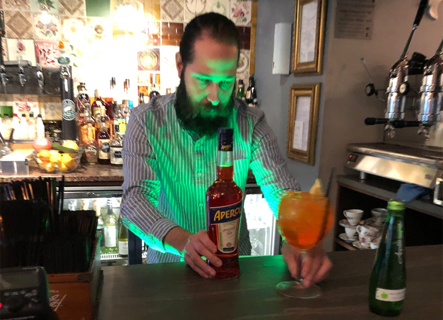 barman setting up appletiser cocktail in a bar - graphic design in newcastle